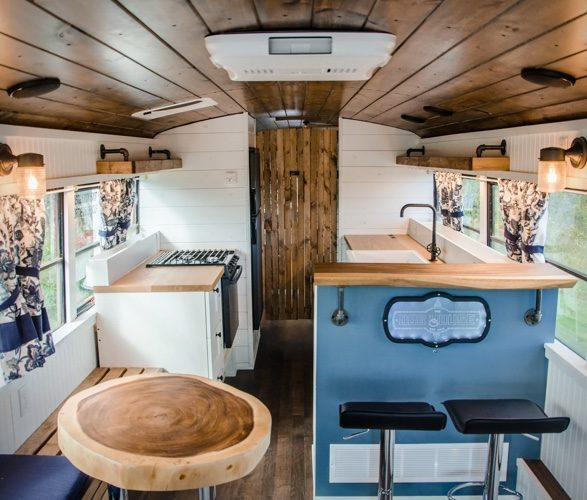 PTP School Bus Conversion - The dog house is one of the nicest tiny homes I've ever seen, with white cladded walls and lots of natural chunks of wood everywhere