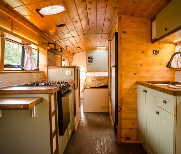 Interim wooden design in the PTP School Bus Conversion. Natural colours, mint green cupboards, and a real homely vibe