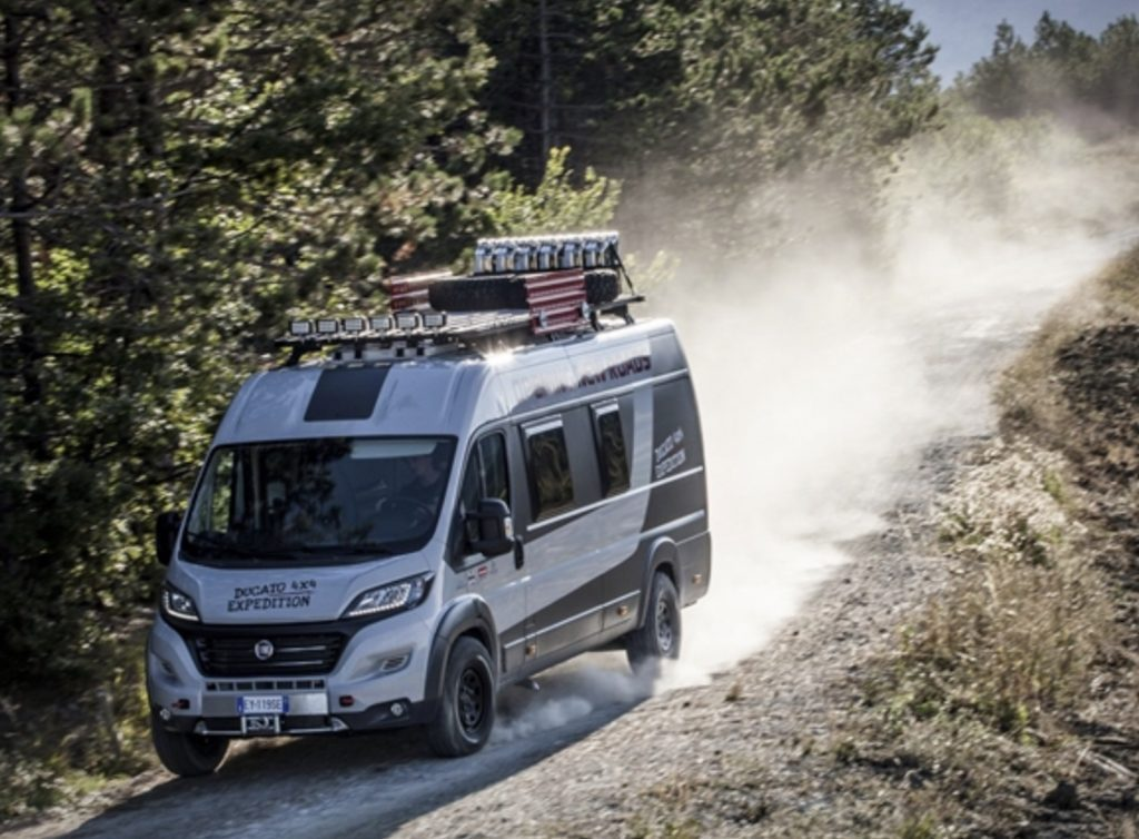 Fiat Ducato camper going down dirt road