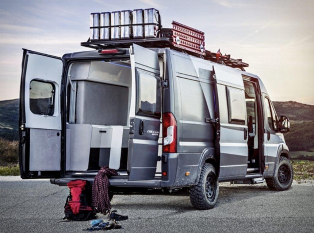 Exterior of van with back doors open and bed down