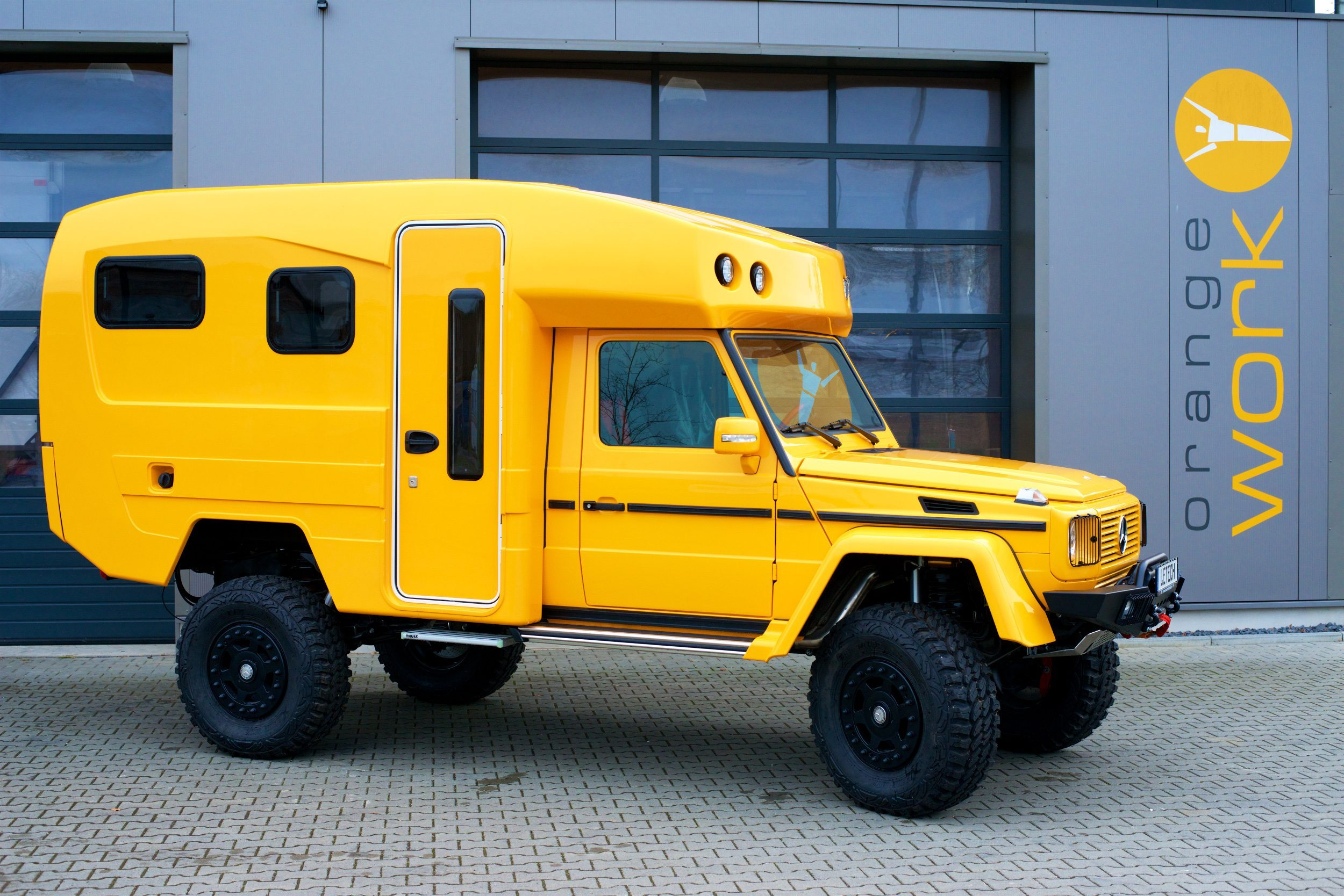 off road trucks - Yellow ExpeditionMobil