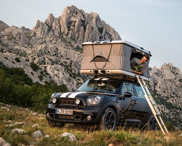 Man sitting in rooftop tent