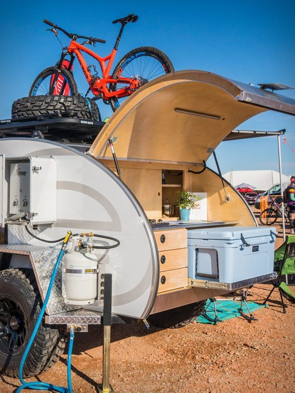 Best Teardrop Trailers - Escapod trailer with kitchen open and bike on roof