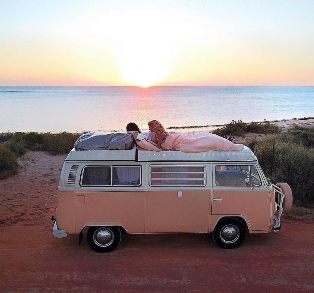 travel in a van - pink VW
