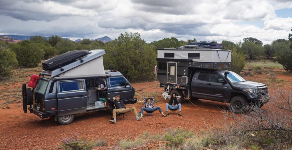 Toyota Tundra Camper with an off-road VW relaxing