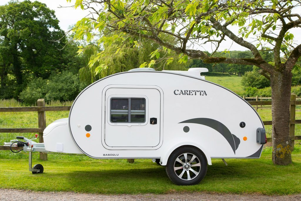 White Caretta Teardrop trailer by a field
