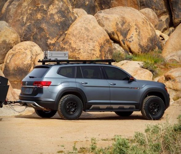 VW Atlas Basecamp side on travelling through rocky terrain