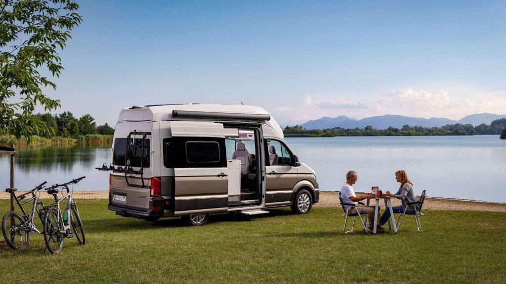 VW Grand California near a lake