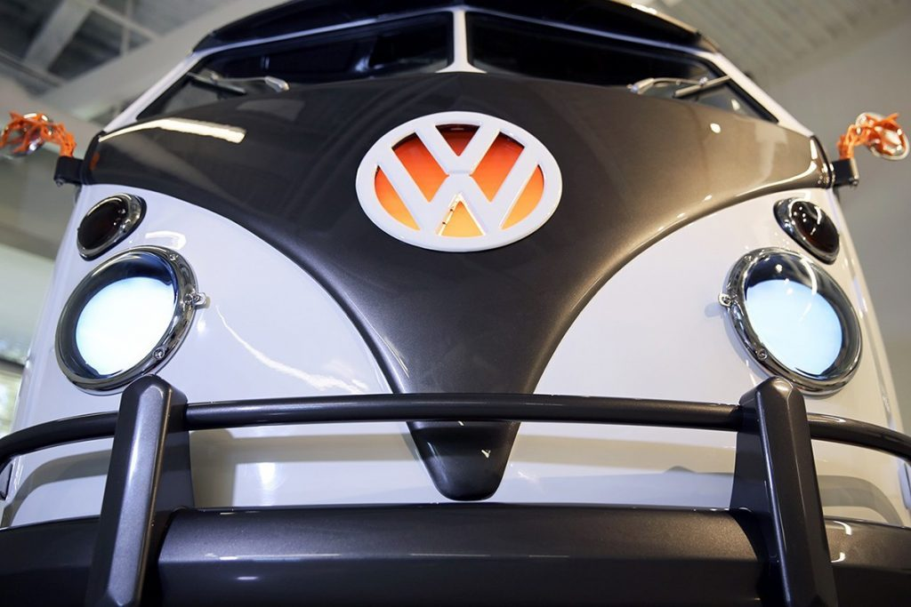 Vw Electric Campervan looks like the iron giant close up, with two white eyes as the headlamps and a black front bumper that looks so stylish!