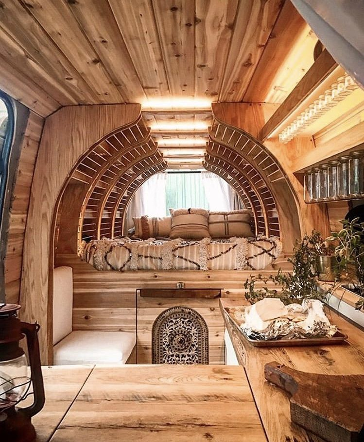 Wooden van interior with curved shelving.