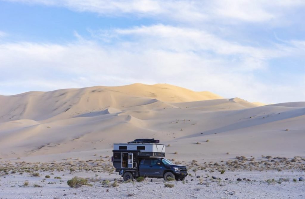 Four wheel camper in desert.