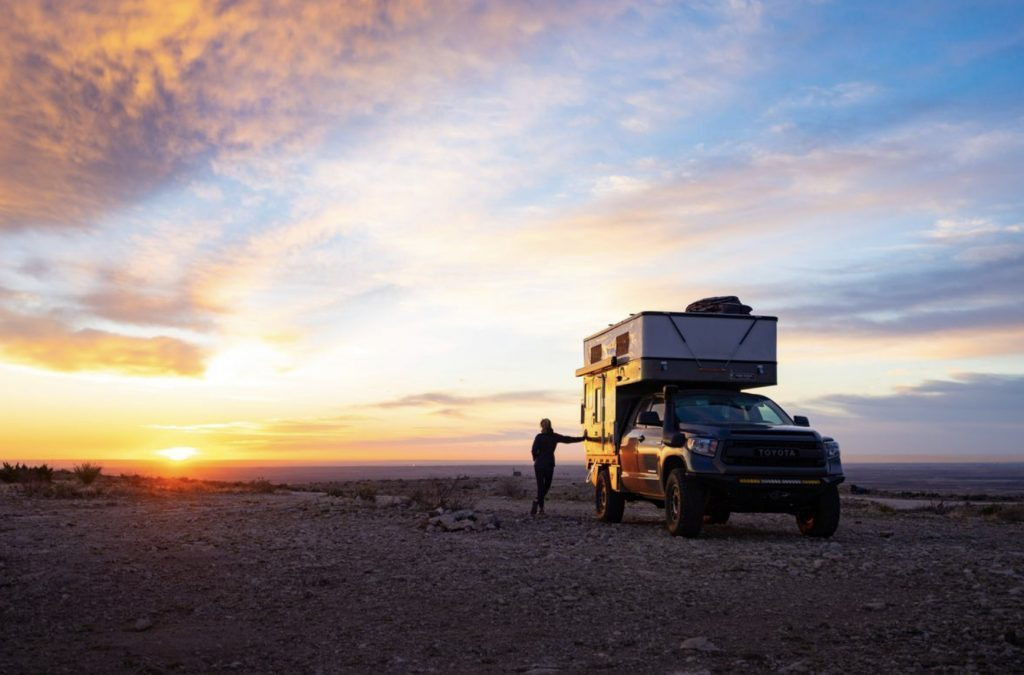 Living in a four wheel camper- camper in sunset.
