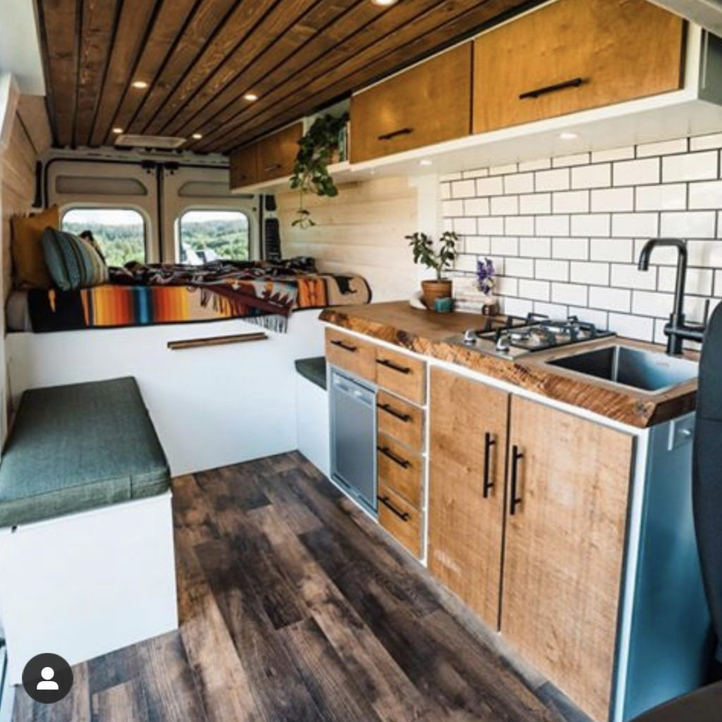 Sprinter van conversion interior, best camper van gear, mattress.