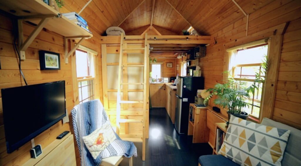 Wooden interior of tiny home.
