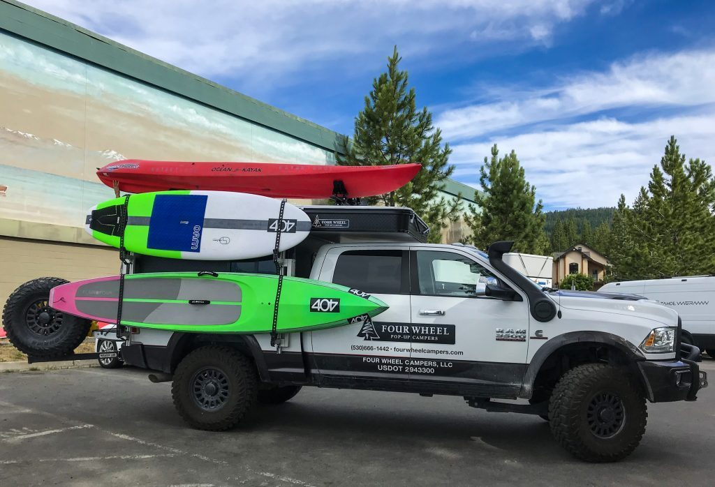 The new camper kitted out with a surfboard, paddle board and a kayak on the roof