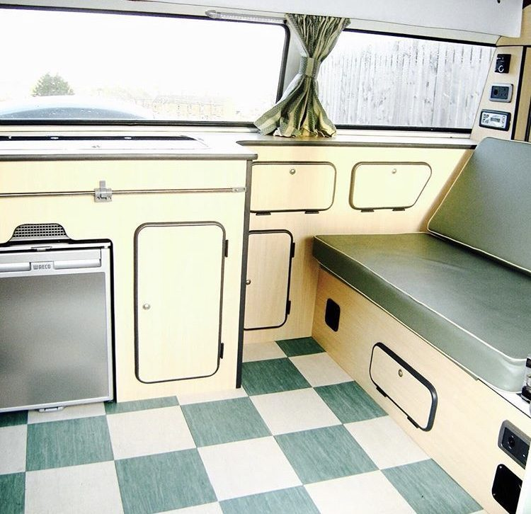 Mint green vintage interior of VW campervan.