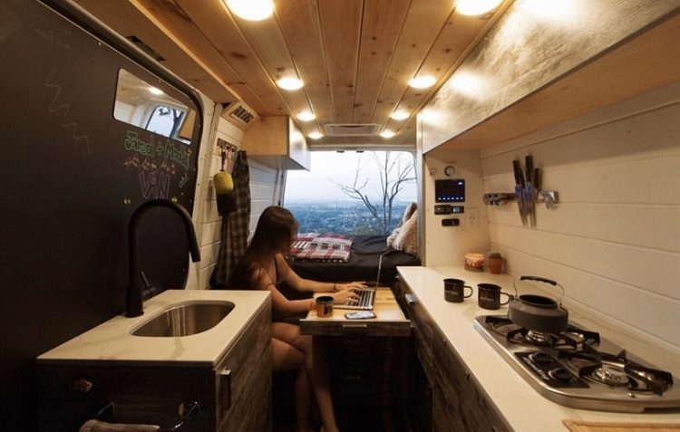 Camper life- woman working inside van