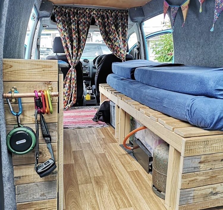 Pretty wooden interior of VW Caddy Camper.