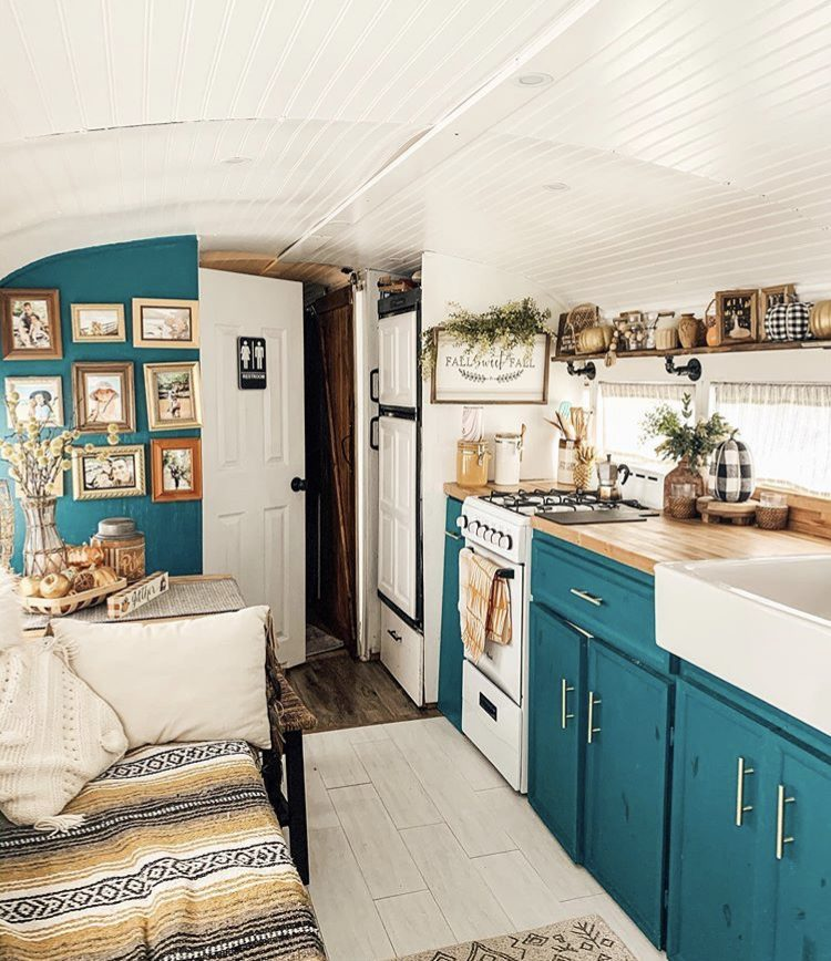 School bus conversion blue kitchen.
