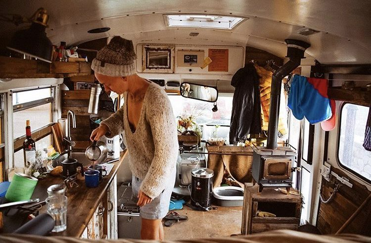 School bus conversions, making coffee in bus.