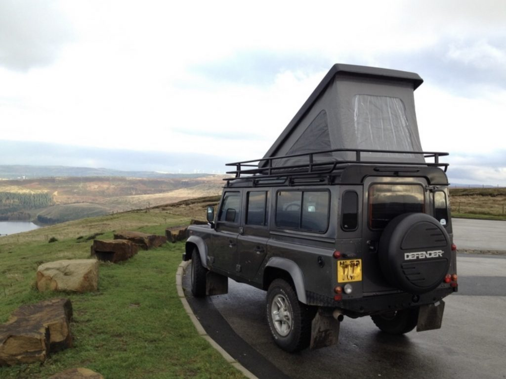 Land Rover defender with roof popped up