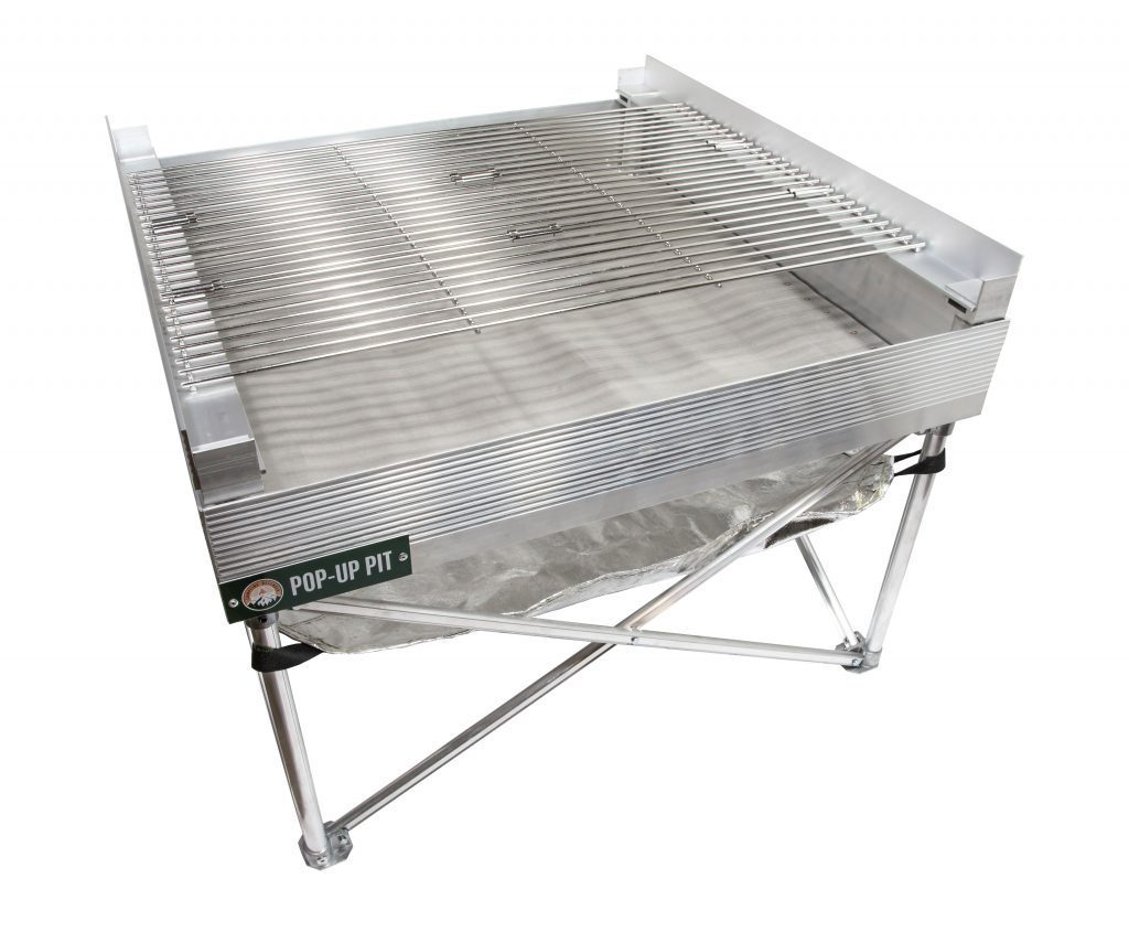 portable fire pit complete with grill attachment and heat shield