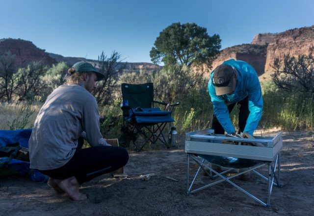 Setting up the portable fire pit on dry earth. It only takes 60 seconds to erect!