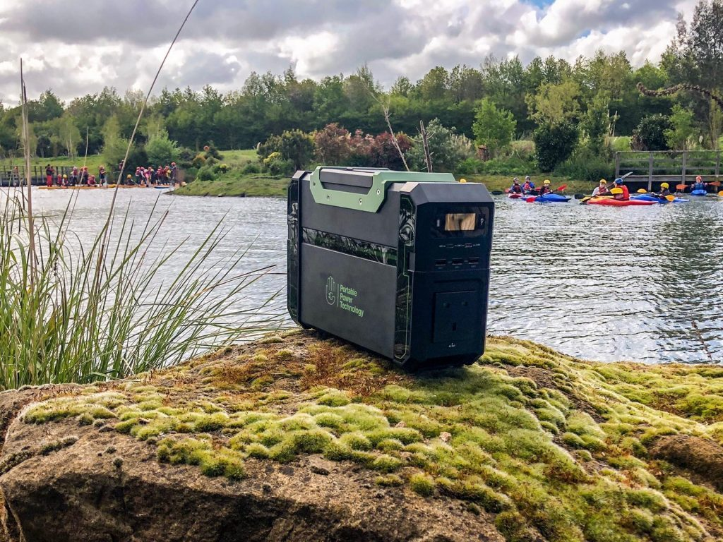 portable power pack on a rock near a water sports class