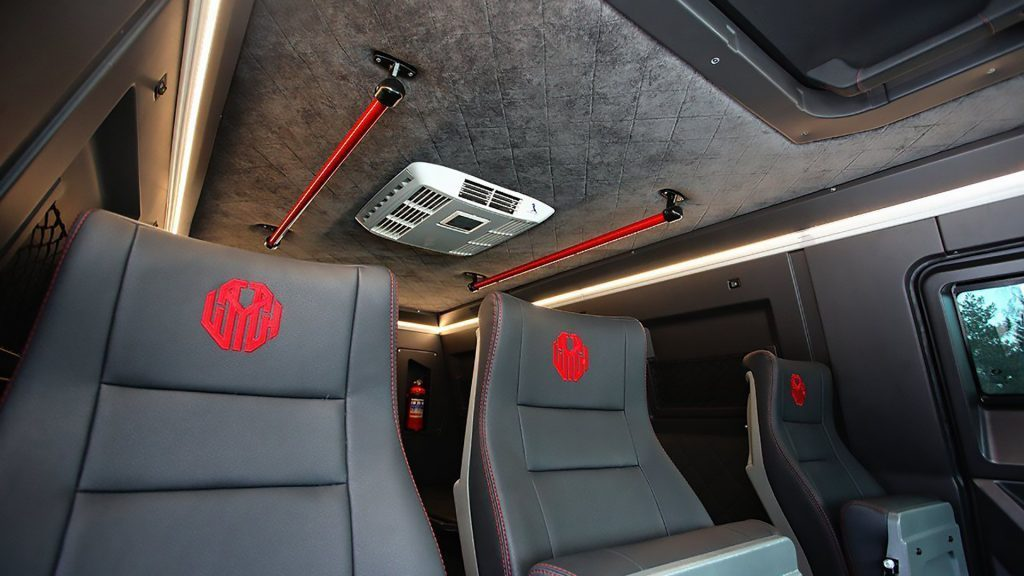 Avtoros Shaman interior seats with embroidered logo and leather plush material.