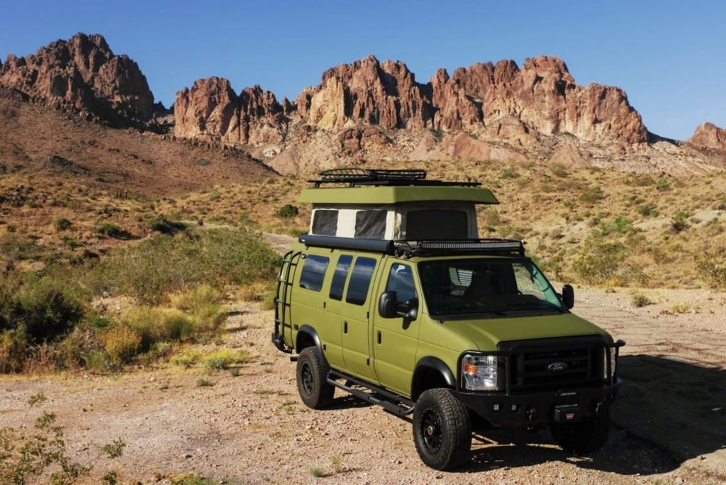 Best RV - green Sportsmobile exterior with pop top up