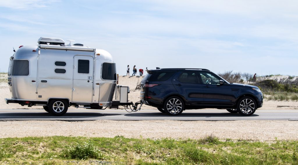 Best RV - exterior of Airstream Caravel attached to a car