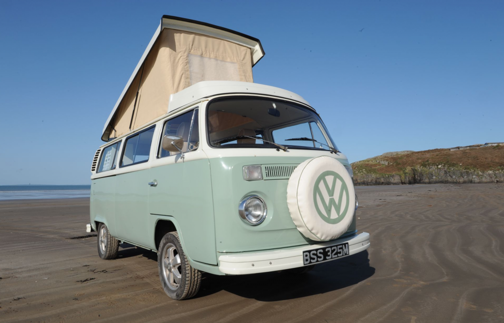 Best RV - mint green exterior of VW bus with pop top up
