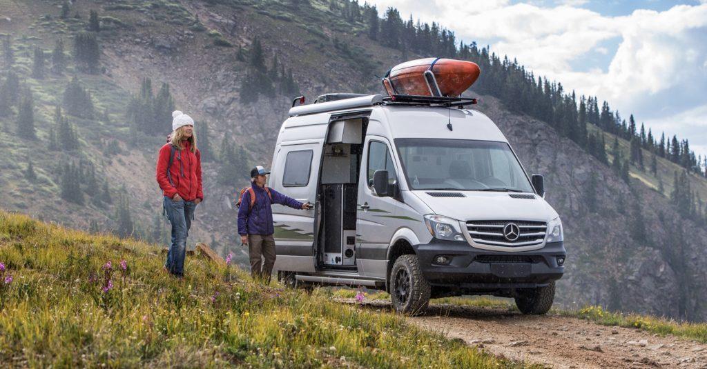 Best Adventure Vans - Winnebago Revel exterior in mountains with kayak on roof