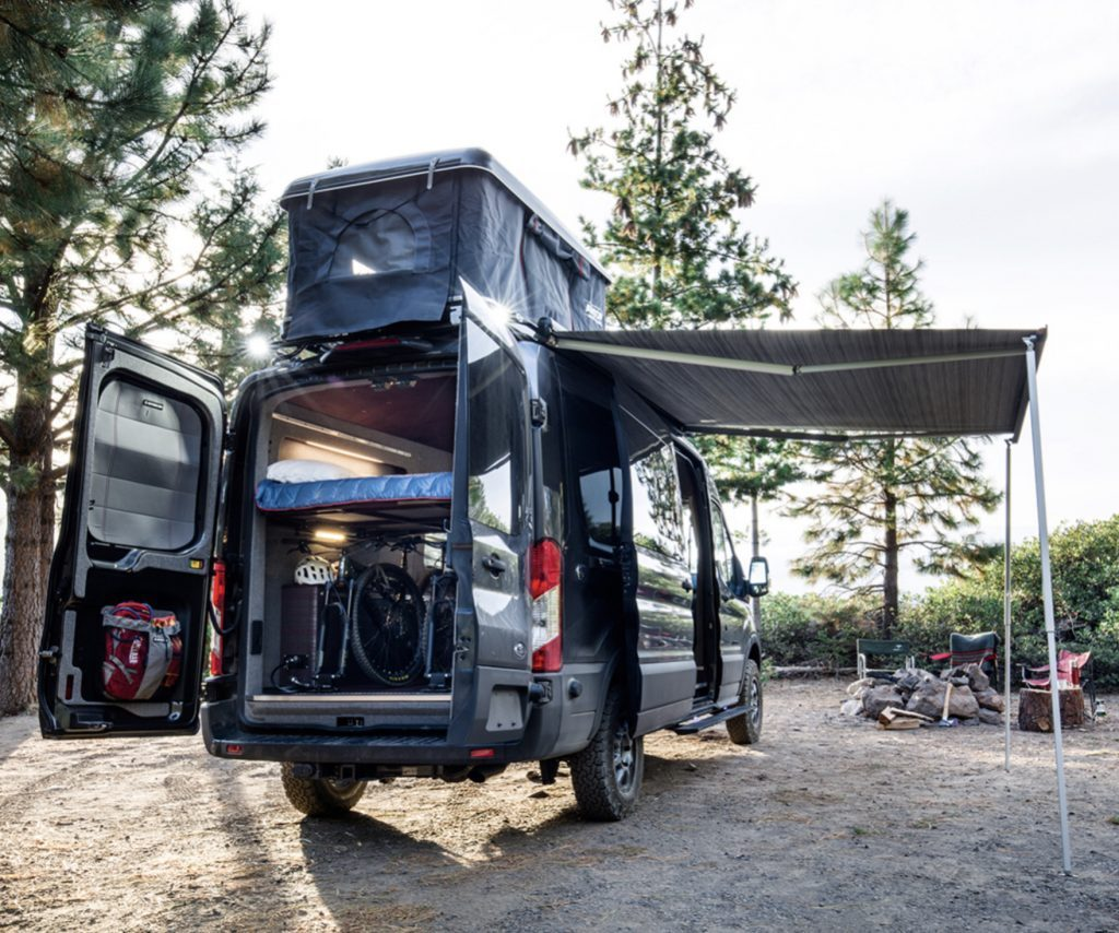 Best Adventure Vans - Exterior of Cascade by Outside Van with roof tent open and awning out