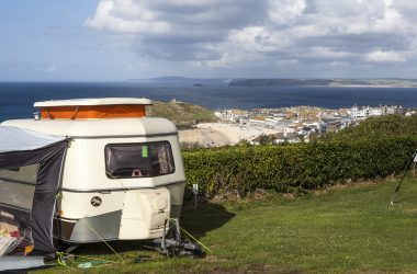 Best Campervan Campsites UK- Trailer overlooking sea