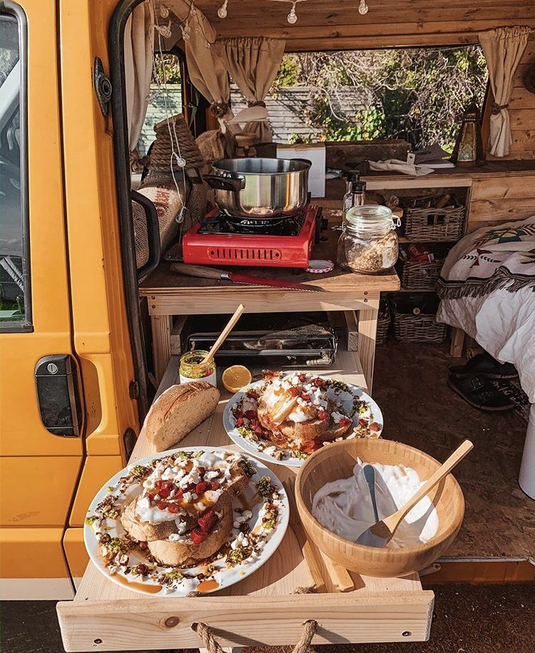 Custom van ideas - pull out kitchen from side door of van with food on.