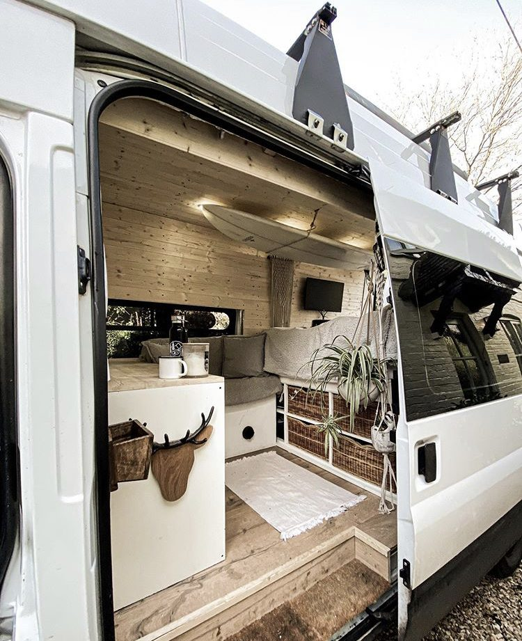 Custom van ideas - wooden interior or van with surfboard attached to ceiling inside.