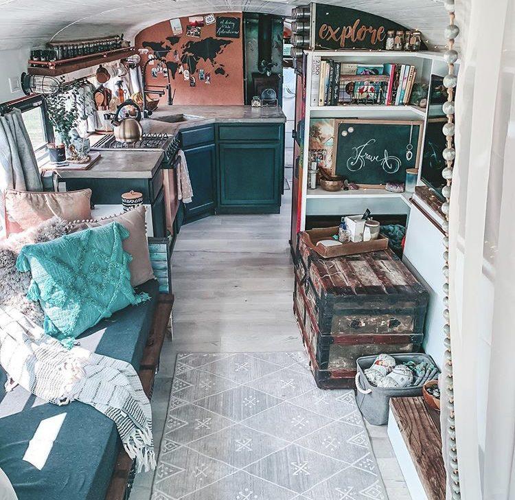 Bus interior, blue kitchen and sofa.