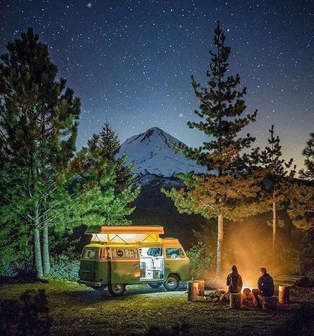 Free camping : VW camp set up in front of snowy mountains