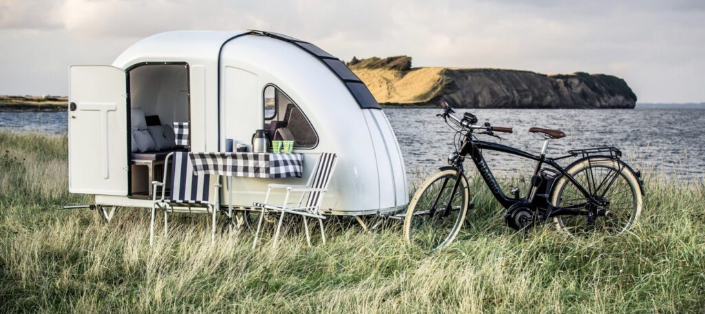 Crazy campervans - bike camper exterior next to bike