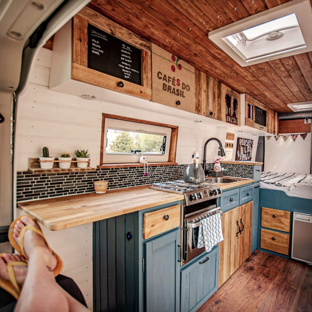 Blue kitchen campervan interior