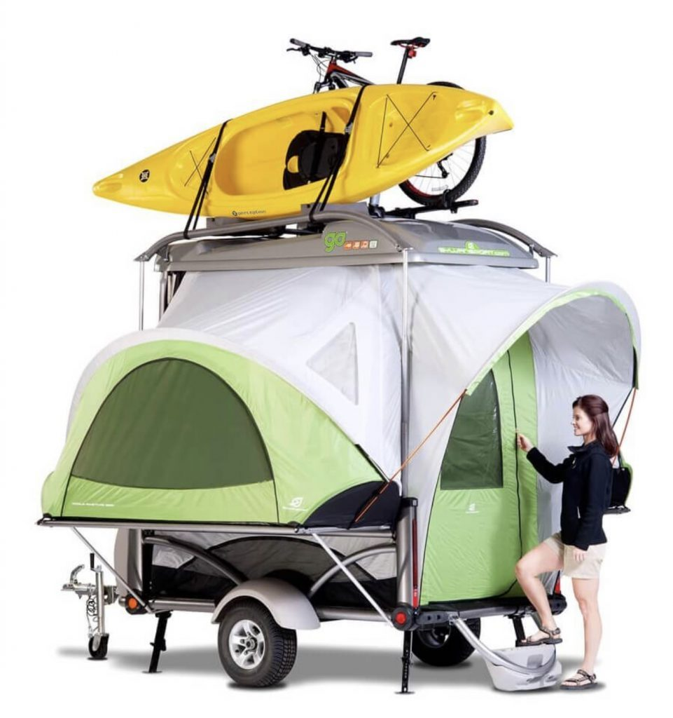 Expanded trailer tent with kayak and bike on top.
