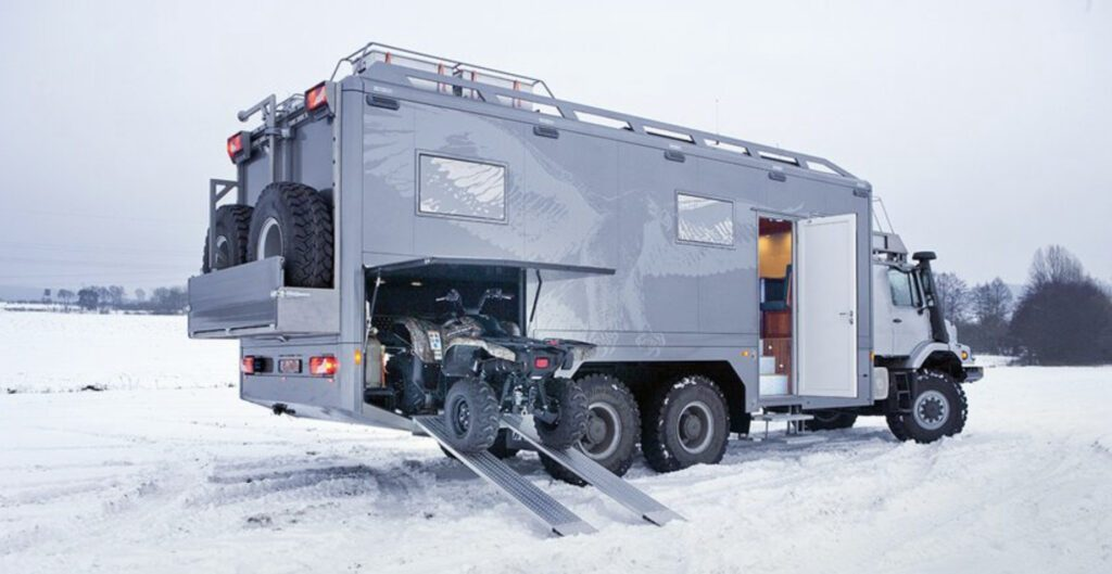 Crazy campervans - exterior of Zetros with Quadbike going in