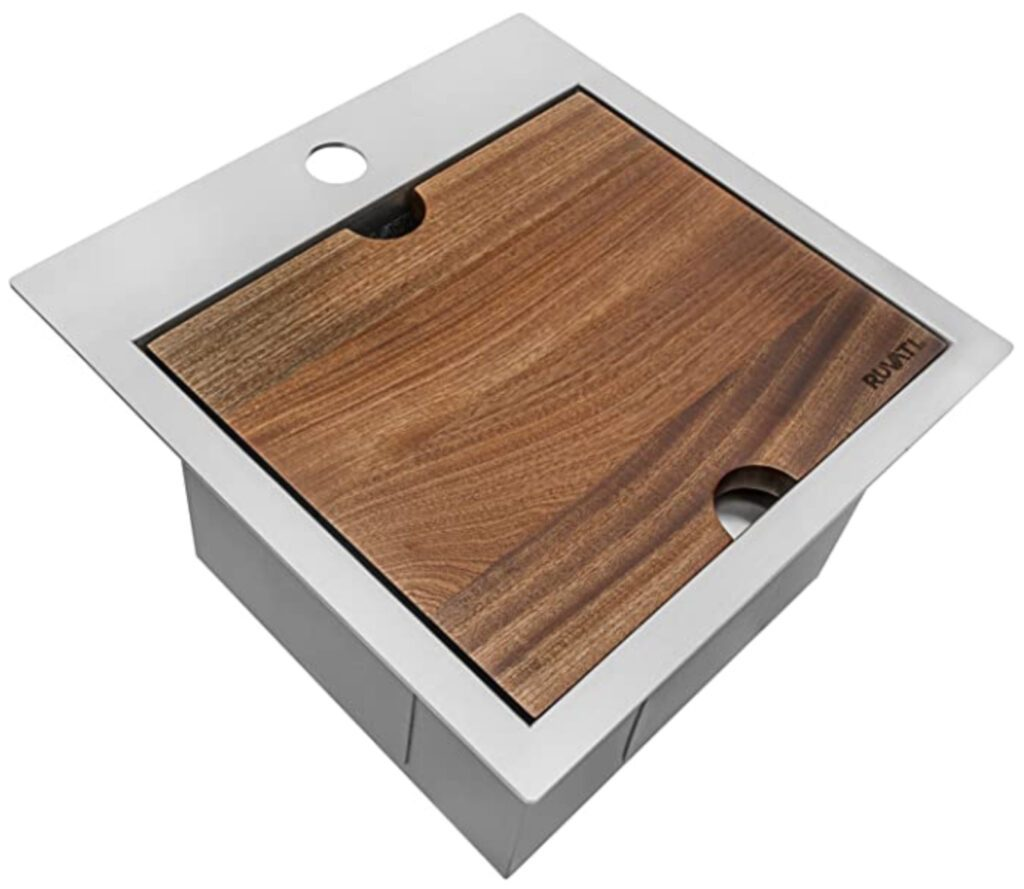 Sink with chopping board on top