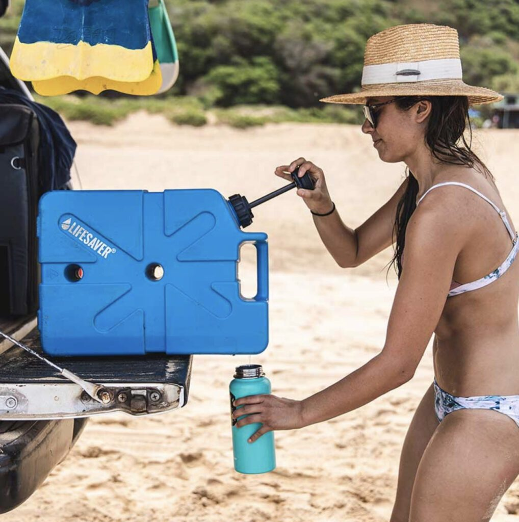 Woman using Lifesaver jerry can on beach