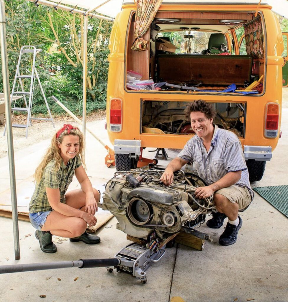 man and woman repairing van's engine