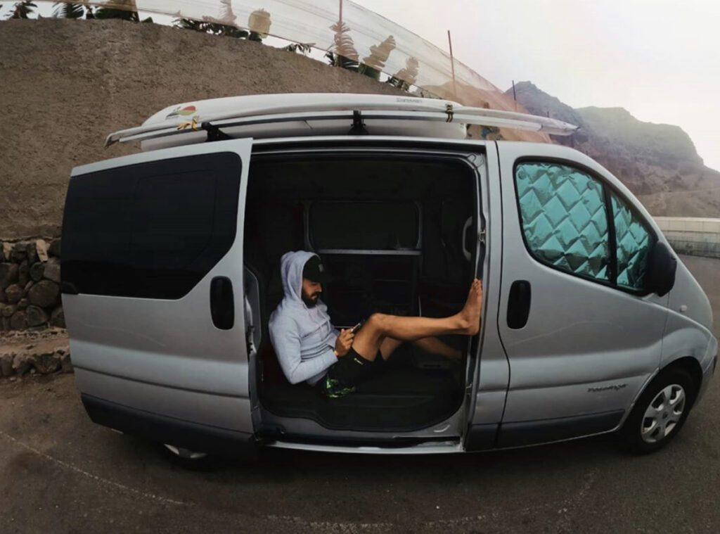 Van dwelling - man in van in car park