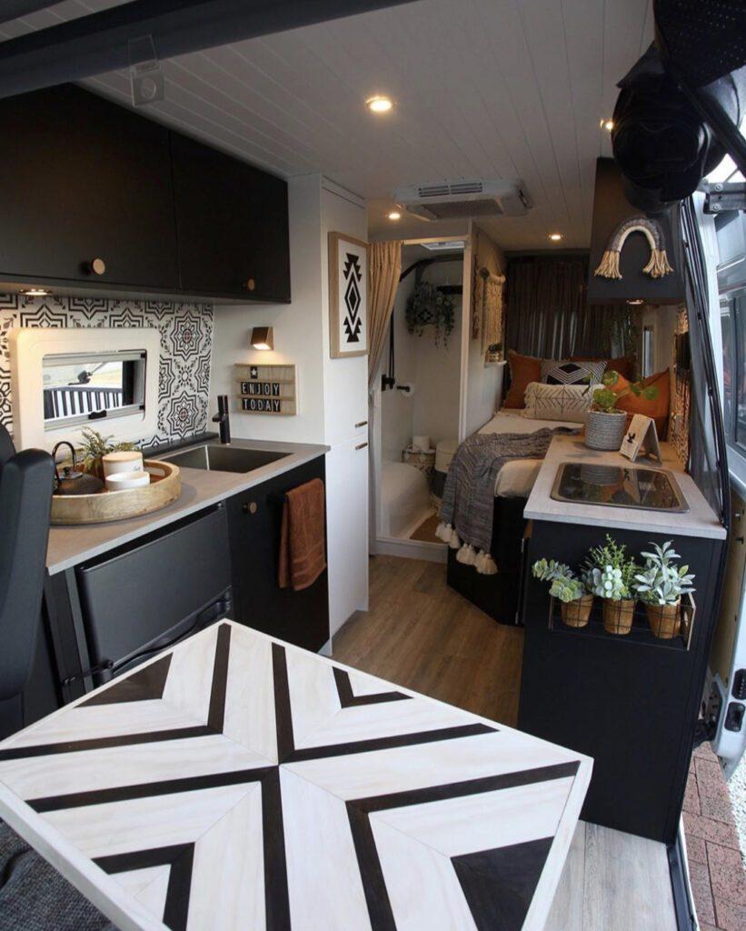 Camper van with bathroom - next to the bed