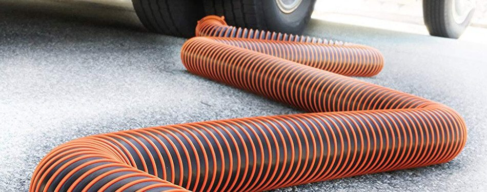 RV sewer hose snaking across the ground