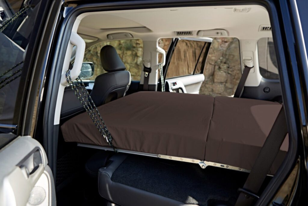 SUV camper conversion kit - bed extended in car